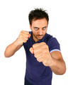 Young Aggressive Man Show His Fists - PhotoDune Item for Sale