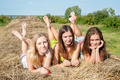 Three attractive women laying on hay stack - PhotoDune Item for Sale