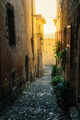 Narrow cobbled street  in the old village France. - PhotoDune Item for Sale