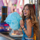 teen at fair eating candy floss or cotton. - PhotoDune Item for Sale