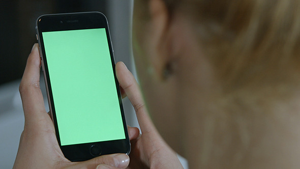 Girl Using and Holding Phone with Green Screen