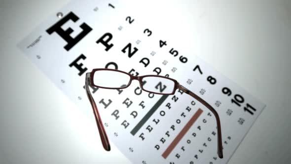 Black Reading Glasses Falling Onto Eye Test