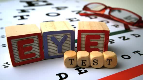 Blocks And Dice Spelling Eye Test Falling Onto Eye Test