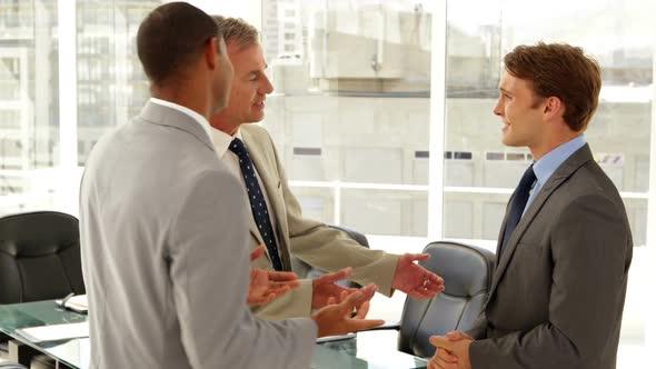Businessmen Talking Together