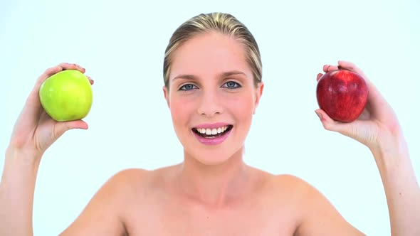 Glamour Woman Holding Two Apples
