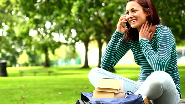 Pretty Student Talking On Phone On The Grass
