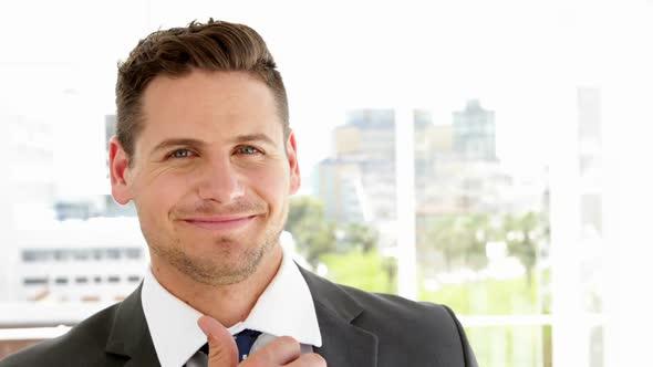 Young Businessman Smiling At Camera