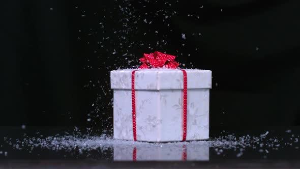 Glitter Falling Onto Christmas Present