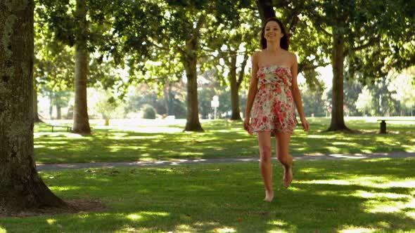 Gorgeous Brunette Bouncing Through Park