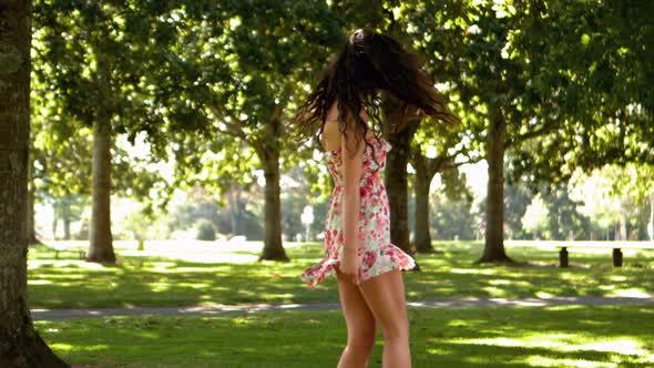 Gorgeous Brunette Turning In Park