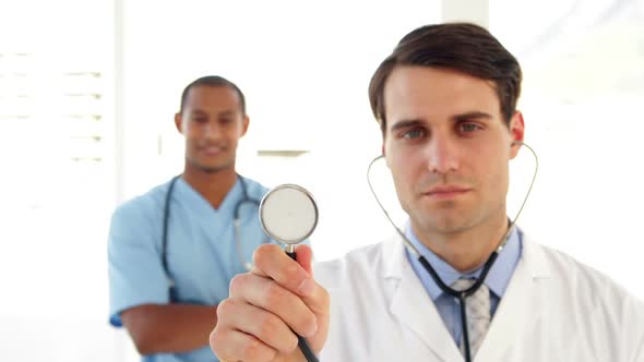 Doctor Holding Up His Stethoscope