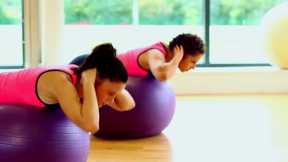 Lovely Focused Women Training Their Bellies