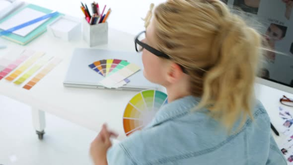 Rear View Of Concentrated Designer Working