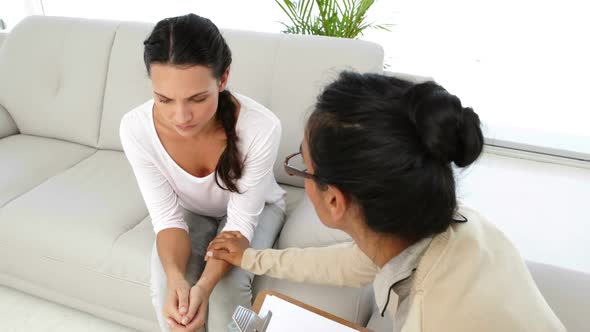 Stern Psychologist Talking To Young Upset Woman