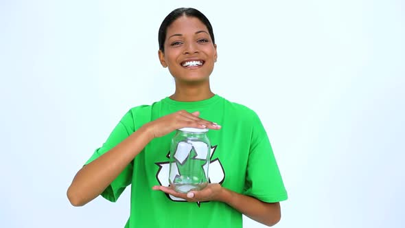 Ecological Woman Holding Jar And Does Thumbs Up At Camera