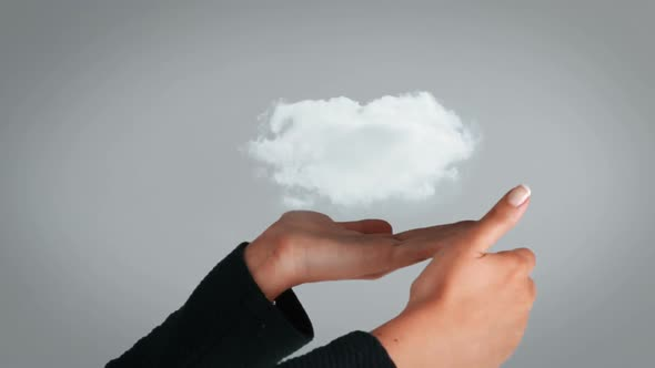 Hand Presenting A White Cloud