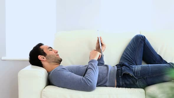 Man Using A Tablet On The Couch 2