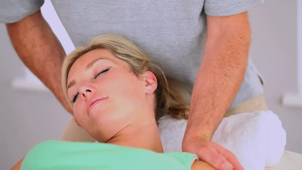 Masseur Turning Clients Neck
