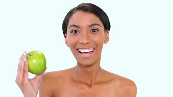 Woman Holding A Green Apple 1