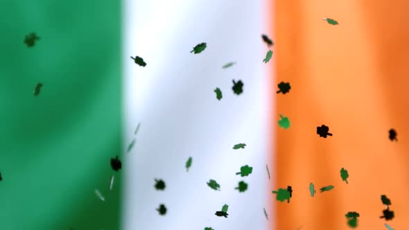 Shamrock Confetti Falling On Irish Flag