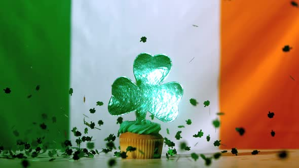 Shamrock Confetti Falling On St Patricks Day Cupcake