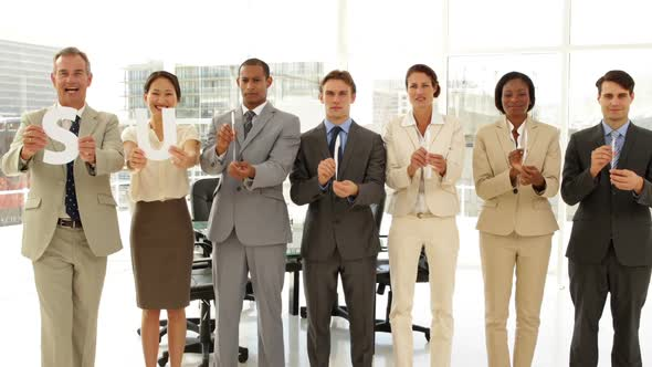 Happy Business People Holding Letters Spelling Success
