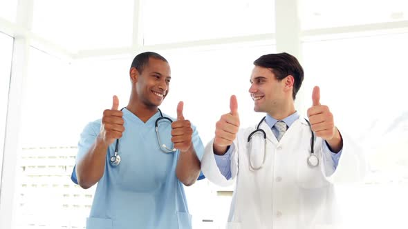 Happy Surgeon And Doctor Giving Thumbs Up