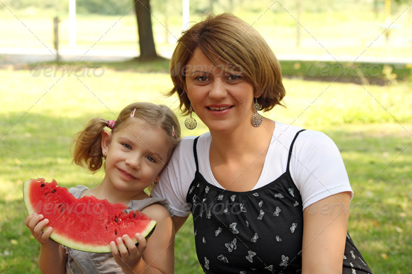 Mother and daughter with watermelon - Stock Photo - Images