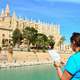 a tourist in front of Majorca Palma Cathedral  at Balearic Islan - PhotoDune Item for Sale