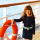 little girl standing on deck of cruise ship - PhotoDune Item for Sale