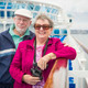 Happy Senior Couple Enjoying The View From Deck of a Luxury Passenger Cruise Ship. - PhotoDune Item for Sale