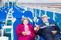 Happy Senior Couple Relaxing On The Deck of a Luxury Passenger Cruise Ship. - PhotoDune Item for Sale