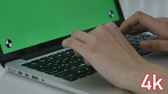 Girl Typing on Laptop Green Screen