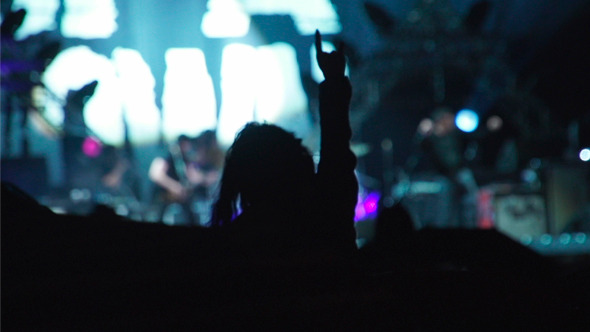Girl Dancing Hands at Rock Concert