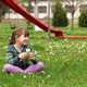 happy little girl sitting on grass with ice cream - PhotoDune Item for Sale