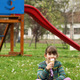 happy little girl sitting on grass and eat ice cream - PhotoDune Item for Sale