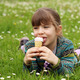happy little girl lying on green grass and eat ice cream - PhotoDune Item for Sale