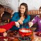 Friends having fondue dinner - PhotoDune Item for Sale