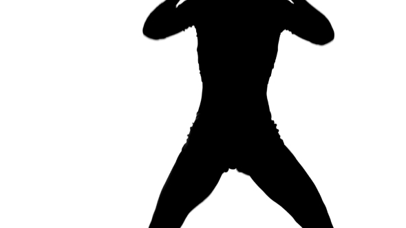 Silhouette Of Girl Dancing Energetically On a