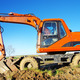 Orange excavator on a working platform - PhotoDune Item for Sale