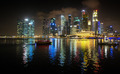 Brilliantly Lit Singapore Skyline from the Harbor at Night - PhotoDune Item for Sale
