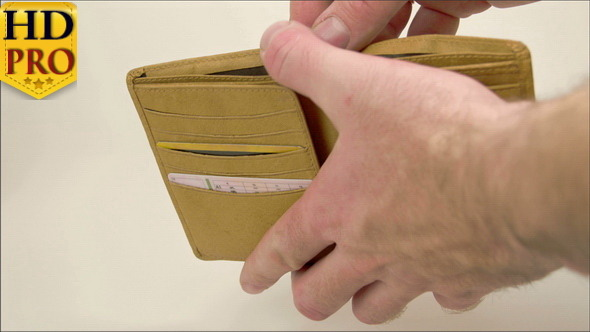 A Hand Opening a Wallet with Euro Bills