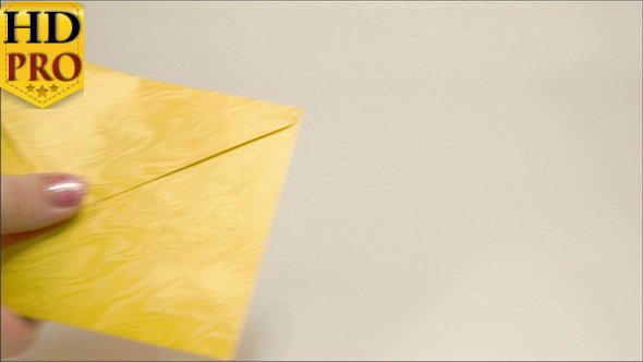 A Yellow Small Envelope Given to a Lady Hand