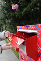 Hand sending a tax report letter in a red mail box   - PhotoDune Item for Sale