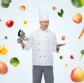 happy male chef cook opening cloche - PhotoDune Item for Sale