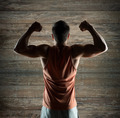 young man or bodybuilder showing biceps - PhotoDune Item for Sale