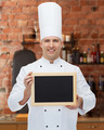 happy male chef cook holding blank menu board - PhotoDune Item for Sale