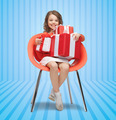 happy little girl with gift boxes sitting on chair - PhotoDune Item for Sale