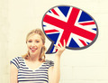 smiling woman with text bubble of british flag - PhotoDune Item for Sale