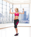 young sporty woman with dumbbells - PhotoDune Item for Sale